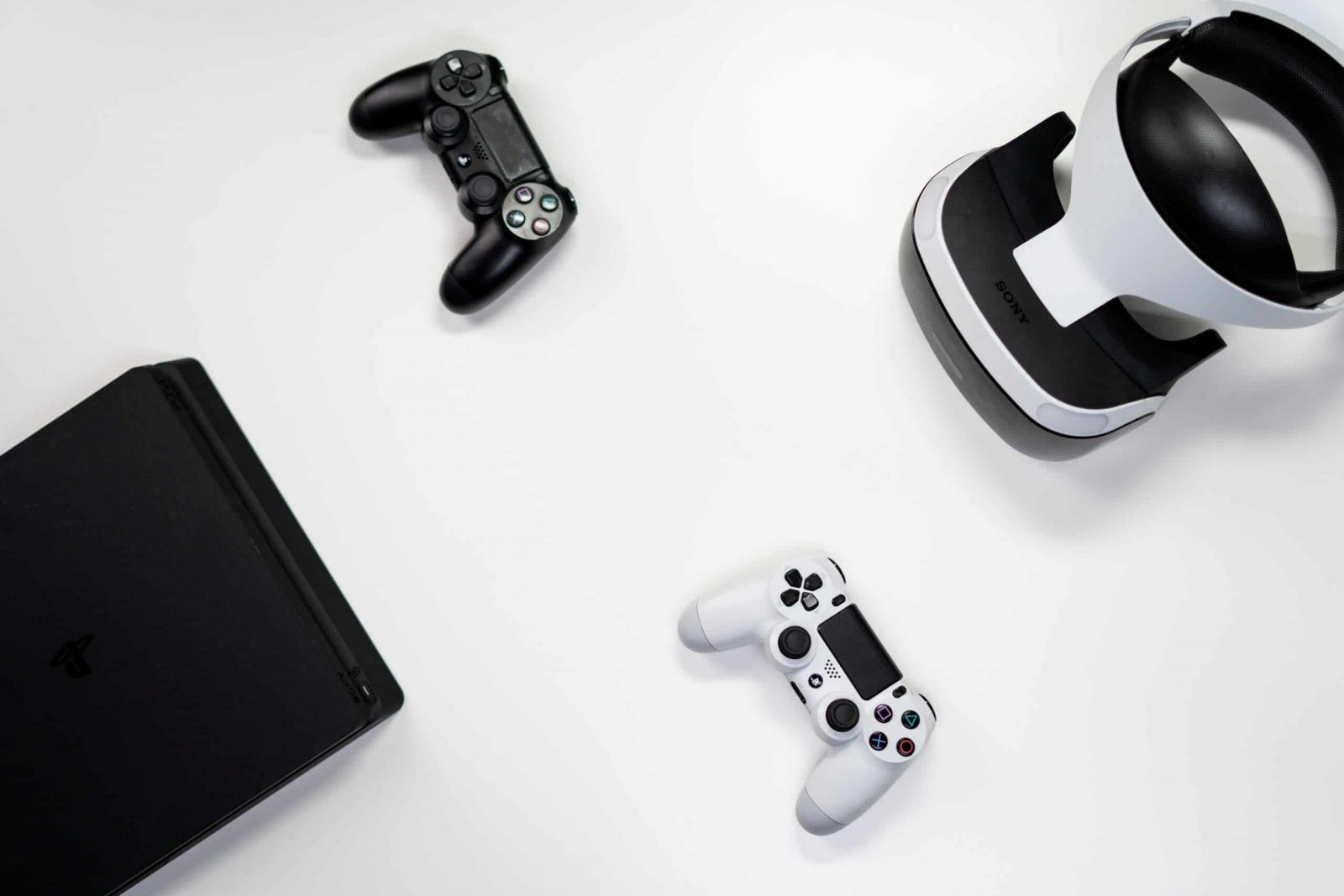 An image showing a Console alongside controllers and a VR headset