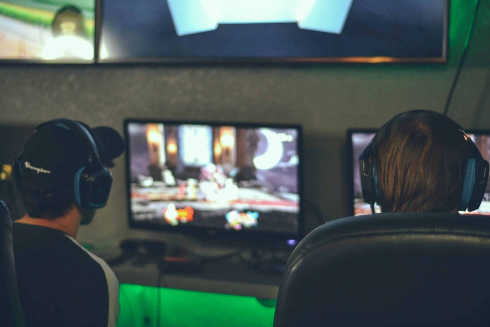 Image of two people gaming.