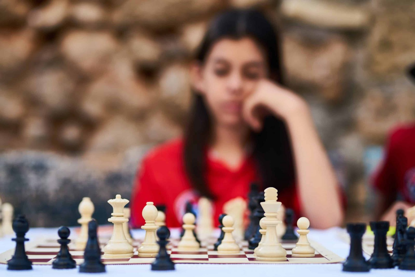 Image of a person playing chess.